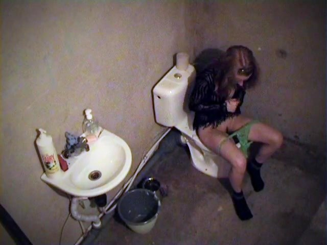 Lady Getting Refreshment At The Rest Room Webcam