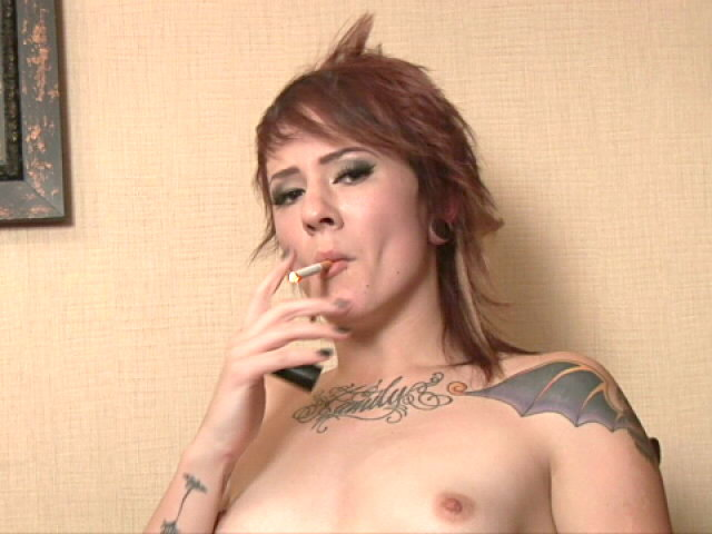 Inked Crimson Haired Teenage Sailor Smoking With Passion At The Digital Camera