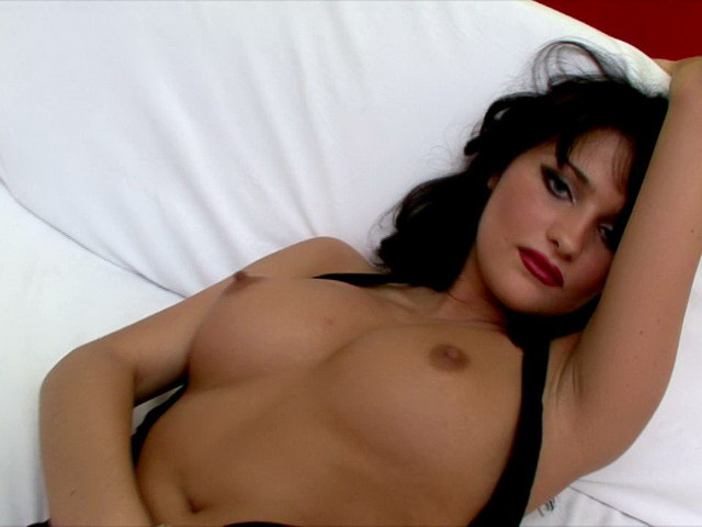 Black-haired Russian Vamp In Nylons And Prime High-heeled Shoes Luysan Displaying Her Figure On Digital Camera